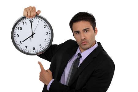 punctual: Hombre de negocios con un reloj Foto de archivo