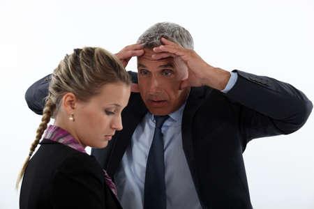 admonish: Chief reprimands employee Stock Photo