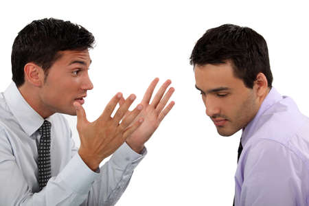 Two young businessmen having an argument photo