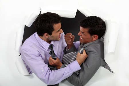 Two businessmen fighting photo