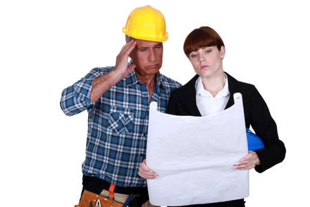disputed: Architect and builder discussing plans Stock Photo