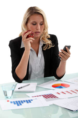 Saleswoman at her desk Stock Photo - 15289986