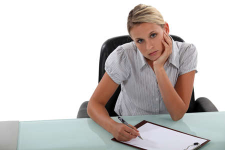 tedious: Bored woman taking notes Stock Photo