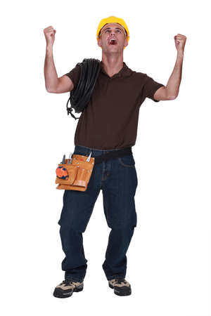 full-length portrait of craftsman shouting for joy photo