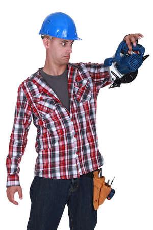 sander: carpenter stunned at sander machine Stock Photo