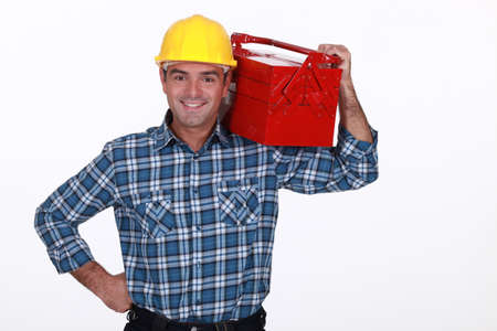 chirpy: Man with a toolbox on his shoulder Stock Photo