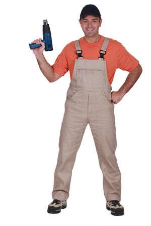 Man holding heat-gun photo