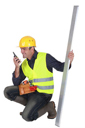 Construction worker with a walkie talkie Stock Photo - 15289611