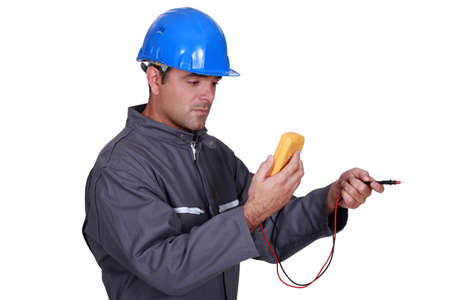 Tradesman using a multimeter Stock Photo - 15289885