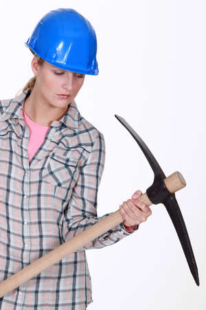 Woman with a pickaxe photo