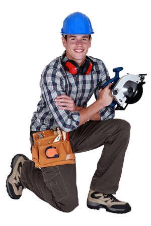 woodworker: Carpenter holding circular saw Stock Photo