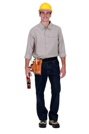 whittle: Carpenter stood holding wood plane