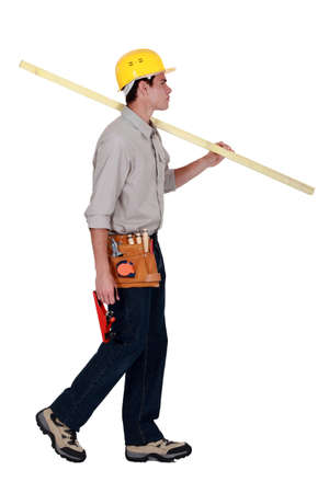 craftsman walking and holding a wooden board Stock Photo - 15289483