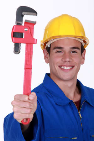 Young man holding wrench Stock Photo - 15290118
