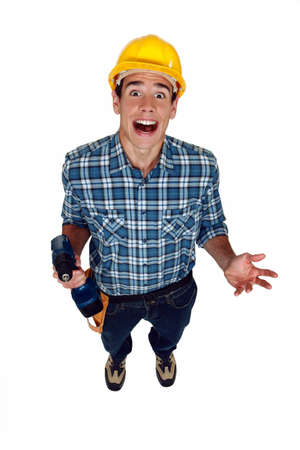 exclaiming: A screaming tradesman holding a power tool