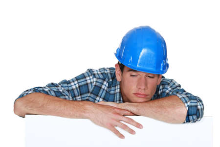 Sleepy construction worker Stock Photo - 15289868