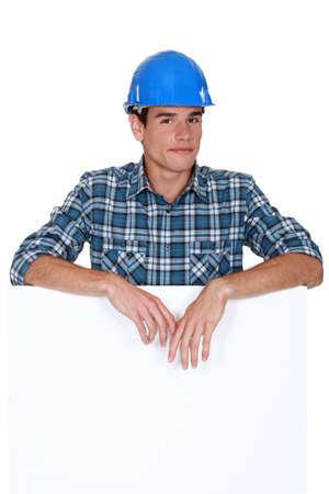 yourselfer: Handyman behind white panel Stock Photo