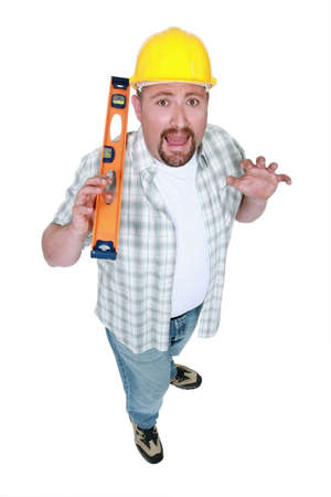Scared builder with a spirit level photo