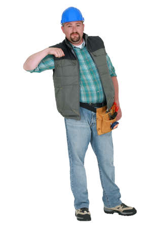 Portrait of a tradesman holding his arm up photo
