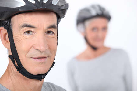 Senior man with a bicycle helmet photo