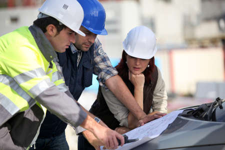 female architect: Construction team on site