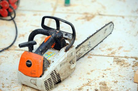 sawyer: Chain-saw on construction site