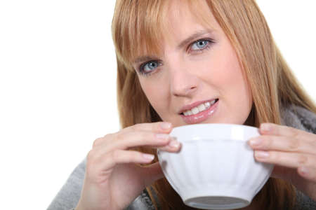 ultimately: Blonde woman with bowl Stock Photo