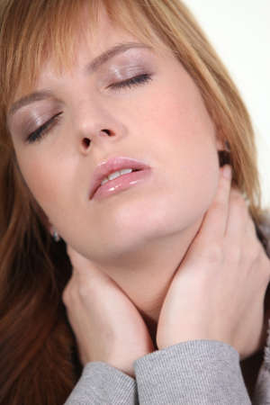 Closeup of a woman with a neckache photo