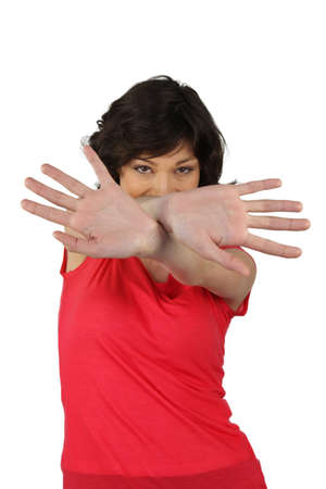 shy woman: woman hiding behind her hands
