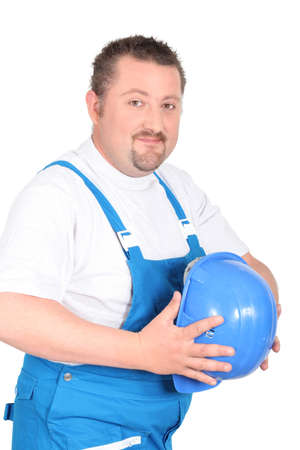portly: Portly builder holding a hardhat in front of his stomach