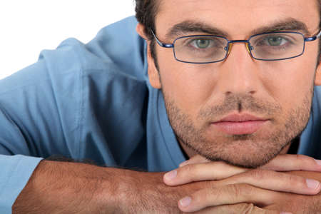 laborious: Bored man wearing glasses