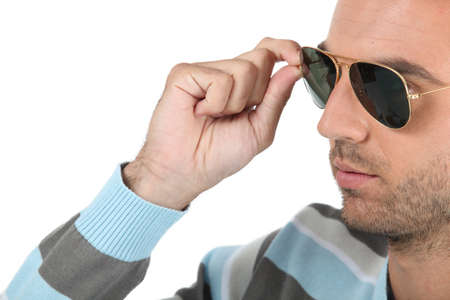 only men: Man wearing sunglasses and stripy sunglasses Stock Photo