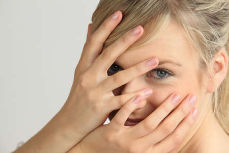 Blond woman with hands on face photo