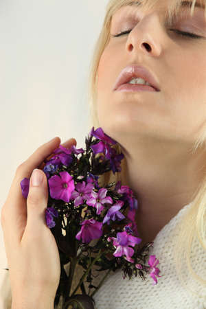 nostrils: Woman smelling a bunch of flowers