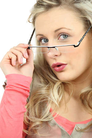 Woman peering over her glasses photo