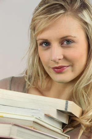 Woman with a stack of books Stock Photo - 15332569