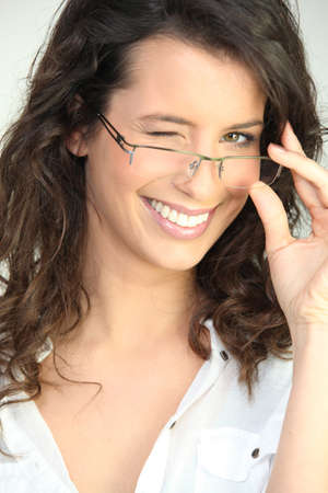 Brunette in glasses winking at the camera photo