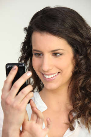 Woman with mobile phone photo