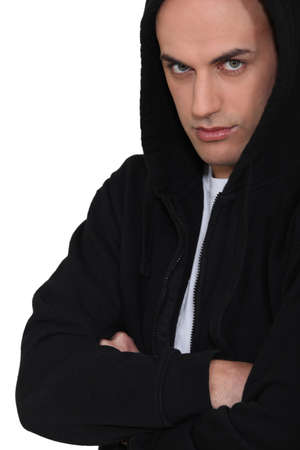 cross arms: Portrait of hooded man