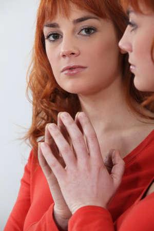 inward: Redhead looking in a mirror