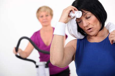 perspiring: Mature women at the gym