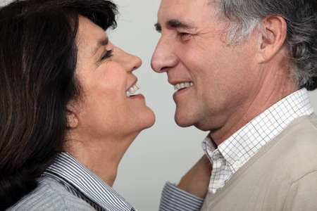 about age: A middle age couple about to kiss.