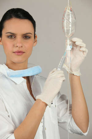 Nurse injecting medication photo