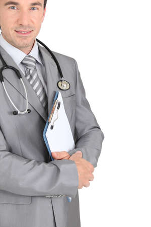 GP with stethoscope and clipboard Stock Photo - 15331777