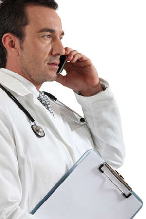 Doctor on phone Stock Photo - 15331702