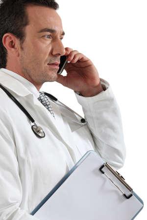 Doctor on phone Stock Photo - 15331702