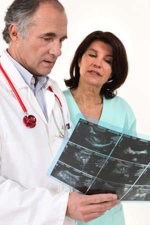 Doctors conferring Stock Photo - 15333762
