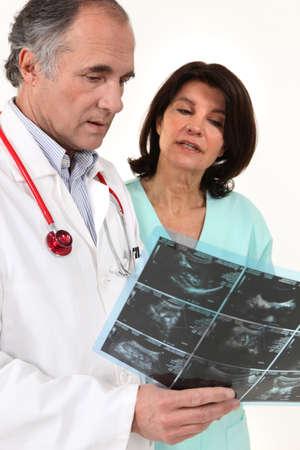 Doctors conferring Фото со стока - 15333762