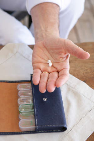 aspirin: Man holding medicine Stock Photo