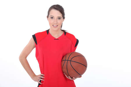 Female basketball player standing on white background photo